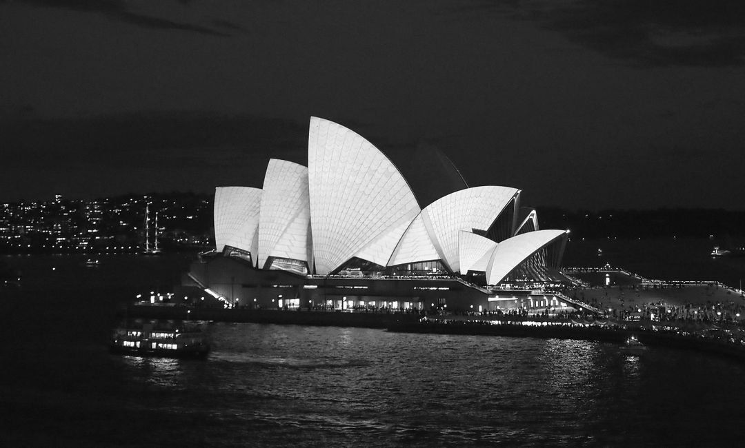 The Sydney Opera House at night, in black and white. Photo by Brendon Thorne / Getty Images