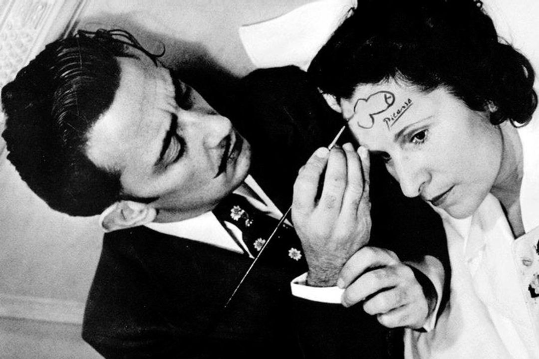 Dali drawing a dick on a woman's forehead.